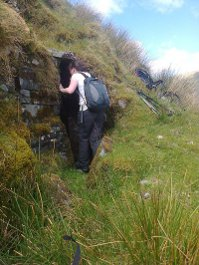 Walker going into O'Maille's Cave
